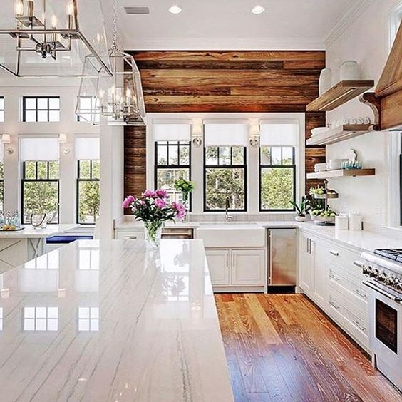 Kitchen goals. I love the mix of clean lines with that rustic reclaimed wood wall. Perfection! . @petersonfunding: