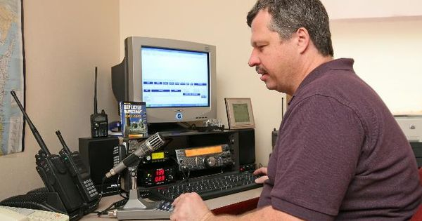 David Schank, call sign KA9WXN, sits at the ham radio set ...