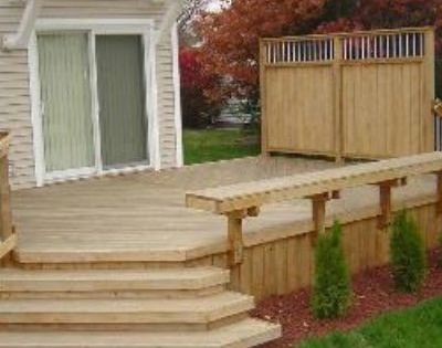 This Cedar Deck In Ames Features Bayed Wrapped Steps Off