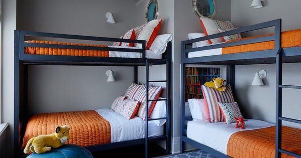 Navy Blue And Orange Boys Bedroom Features Two Sets Of