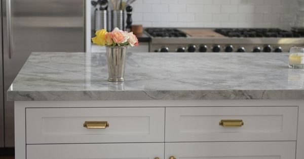 White Veined Countertops With Silver And Gold