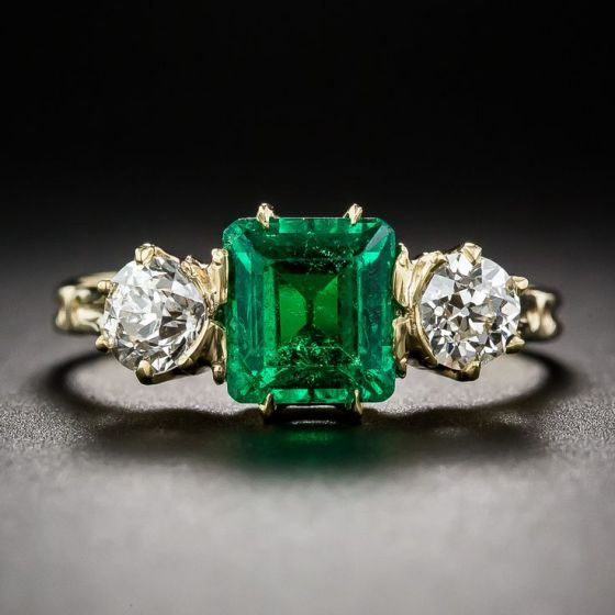 Antique Emerald and Diamond Ring. A rich luscious green and crystalline old mine square emerald-cut emerald, weighing 1.35 carats, shines shoulder-to-shoulder with a pair of sparkling old mine-cut diamonds, weighing .35 carat each (.70 carats total), in this truly superb and stunning late-nineteenth/early-twentieth century three-stone ring elegantly rendered in 14K yellow gold.