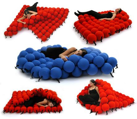 Wait… is this real life? This unique bed is made from 120 medium sized sofa ba