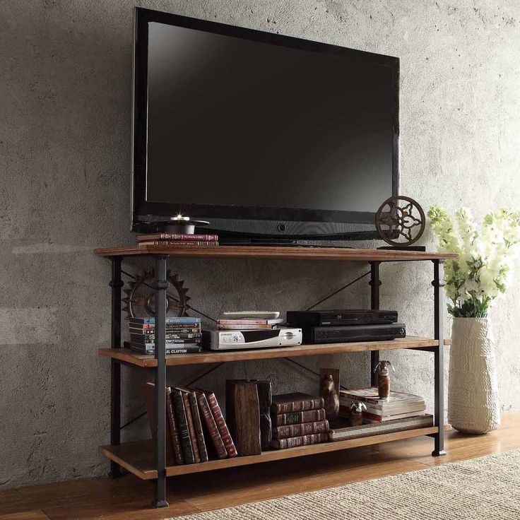 This Myra TV stand has a weathered and timeworn patina allowing traces of natural wood and original colors
