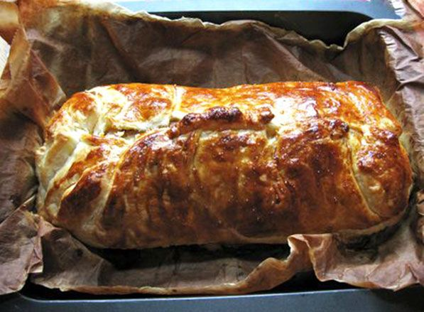The Best Pork Tenderloin Recipe Ever! The Tenderloin is placed on  puff pasty covered with sauted onions & garlic, mustard of choice, cheese & ham . Then it is enclosed in the puff pastry. The