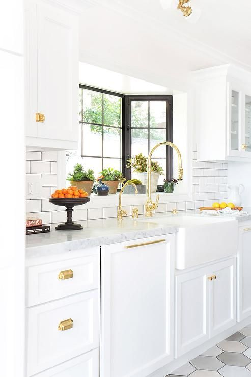 white and gold kitchen features white cabinets adorned with antique brass cup pulls paired with on kitchen cabinets gold hardware id=59615