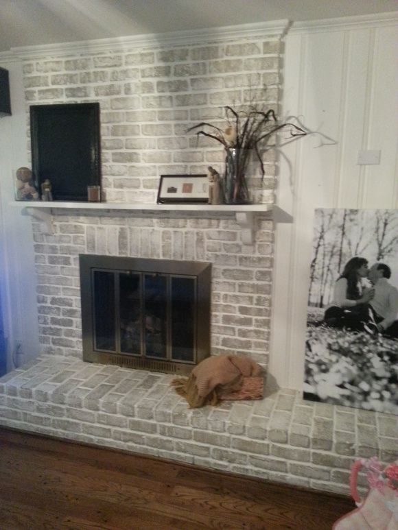 $20 Fireplace Makeover: How to get a whitewashed look on a fireplace already painted white or hide that ugly orange brick from the