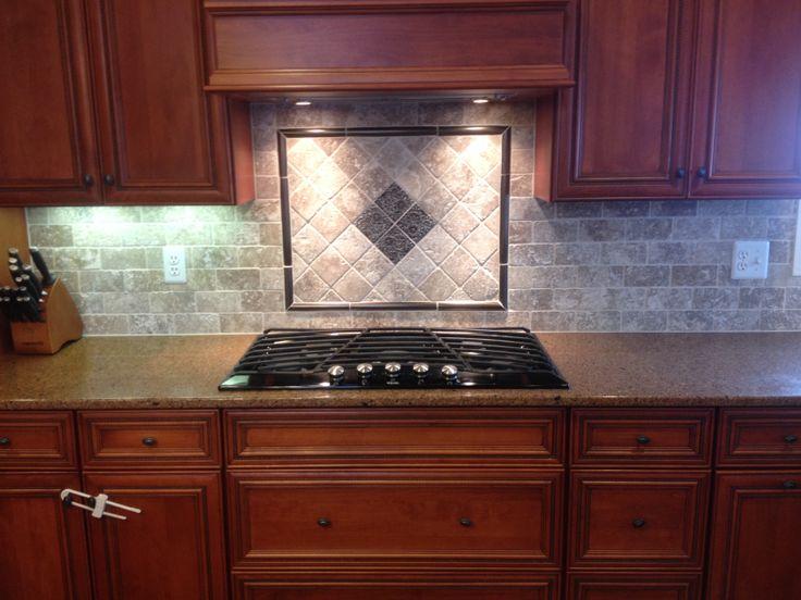 New Tile Backsplash With Mosaic Design Behind Cooktop