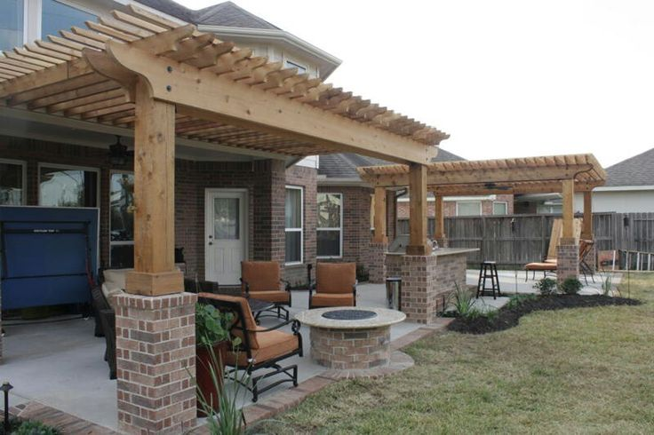 Extended patio with brick border, shade arbors, firepit ... on Extended Covered Patio Ideas id=47131