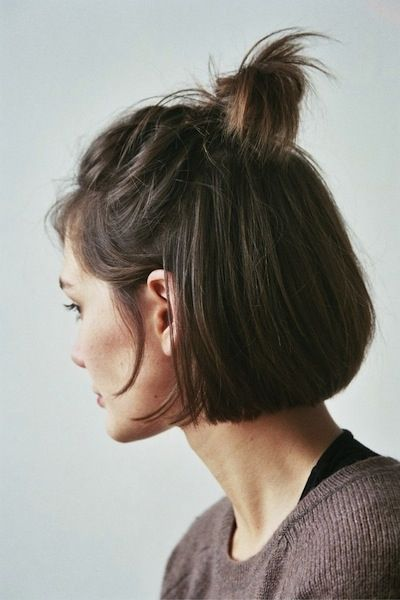 Half-up anything is the definition of effortless glam—simply tie the very top half of your bob into a messy bun and leave a few