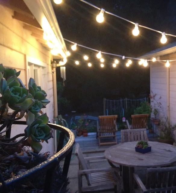 easy to zig zag string lights between two buildings to on awesome deck patio outdoor lighting ideas that lighten up your space id=85943