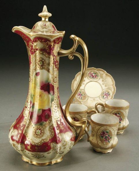 A HAND PAINTED NIPPON PORCELAIN CHOCOLATE SET: