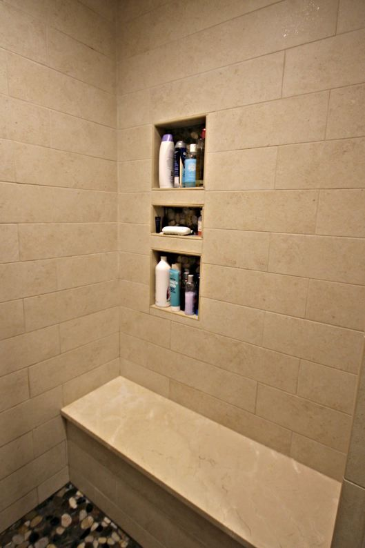 Custom Shower Niche With River Rock Details And Crema