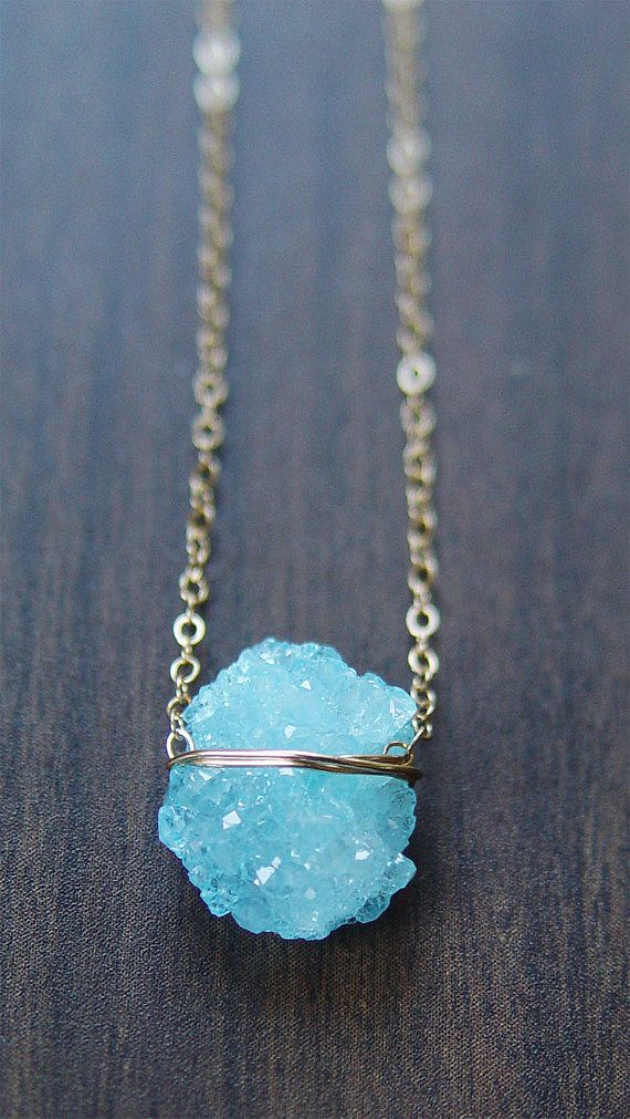 This one-of-a-kind piece is as unique as it is beautiful. Featuring a single beautiful natural blue quartz mineral gemstones which