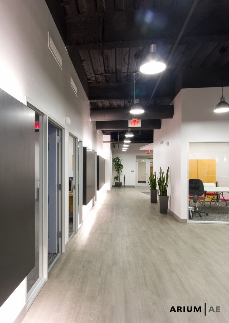 corridor in an office space with black laminate accent on commercial office space paint colors id=72488