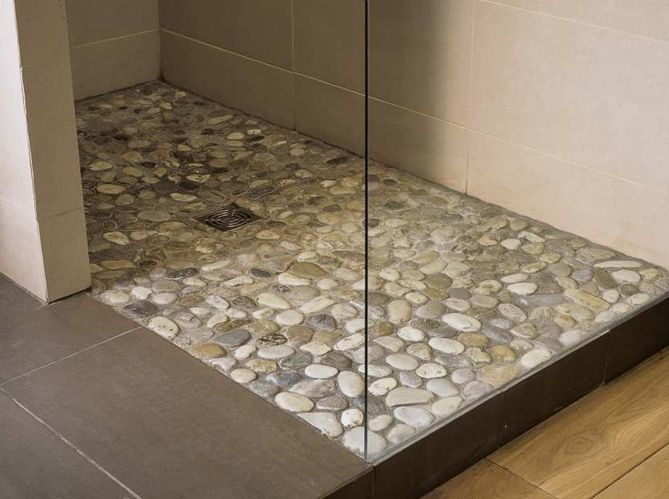 Stunning pebbles for the floor.  I want this in my shower…
