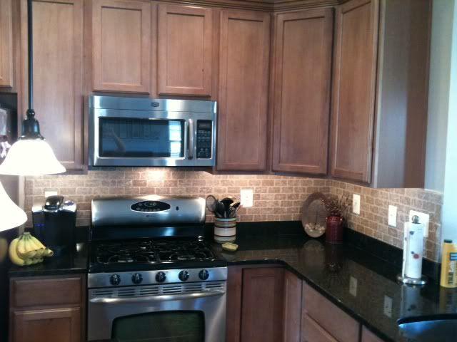 Toffee cabinets, black granite, sandy brick tile ... on Backsplash For Maple Cabinets And Black Granite  id=78551