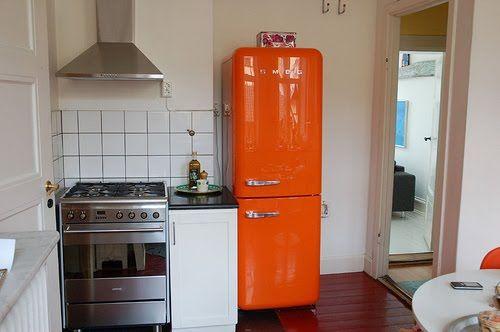 Small Kitchen With An Orange Smeg (refrigerator)! Gorgeous