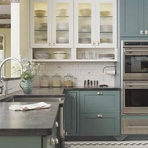 Im thinking if doing two different color cabinets, but I would stick to neutrals.  I like