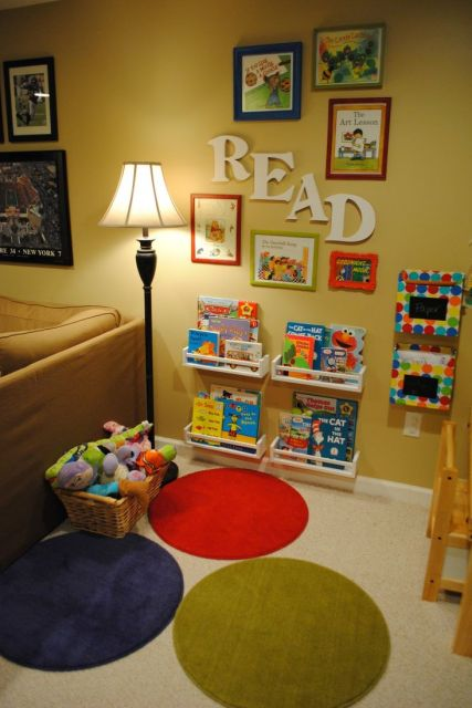 Reading Nook...cute with the framed books!Love the fact it's in the living room! I would love to put an adult reading area near the kids reading area!:
