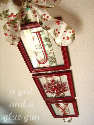 Dollar store frames and snowflake ornament, spray painted, and vinyl letters with ribbon.: