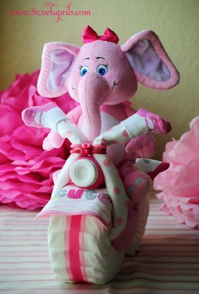 Stuffed animal with a diaper wheel – Baby shower gift idea #babyshower #giftidea