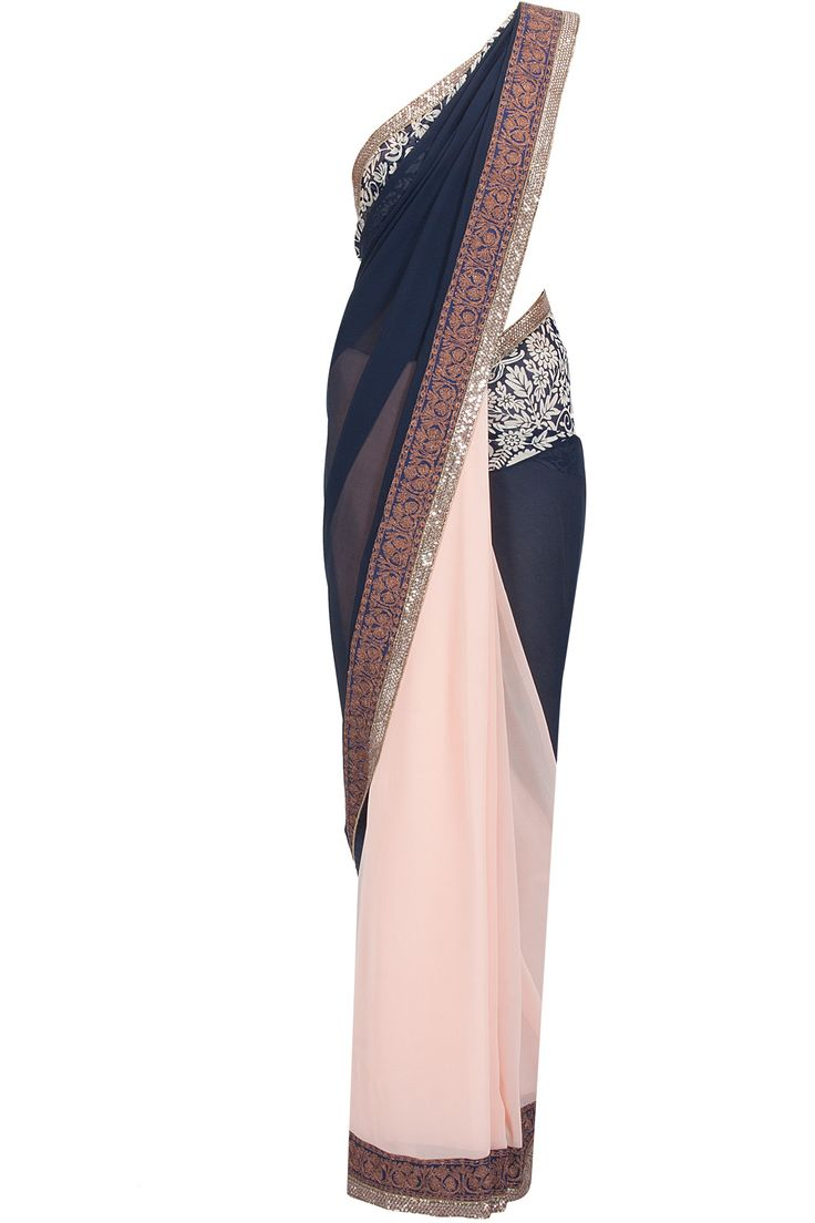Peach and navy blue printed pallu sari with blue raw silk blouse piece available only at Pernia's Pop-Up Shop.