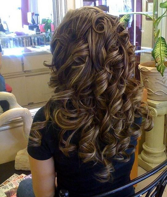Thick curly brunette hair with caramel blonde low-lights