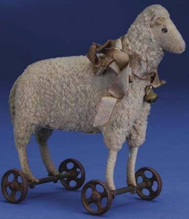 1910 Steiff sheep on wheels, only 6″ . . .  love him!