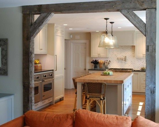 Reclaimed beams and lumber set up in doorways like this and as shelving with vintage industrial mounts can