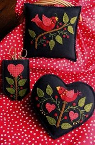 A beautiful pair of Wool Applique pin cushions and scissors case in rich shades of felted wool.  Applique these designs with #8