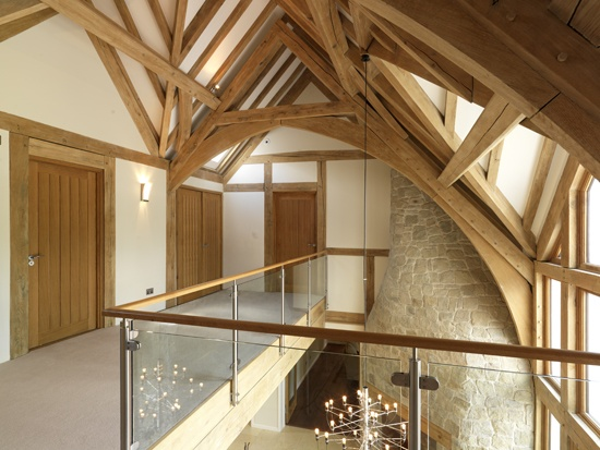 Vaulted Landing Space With Arch Brace Trusses Ceiling