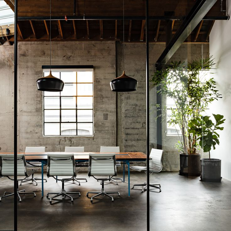 A beautiful conference space furnished with Eames Aluminum Group Chairs by Herma