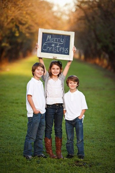 Christmas card photo ideas. I like how the kids are holding the chalk board but