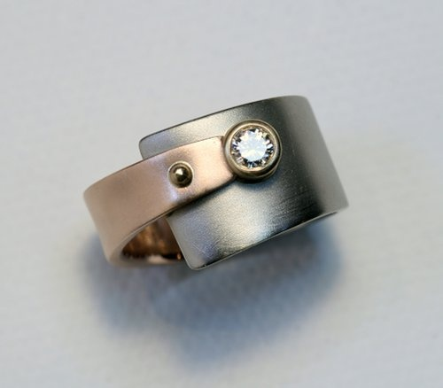 white and rose gold wedding rings by Cooperman Jewelry    I wouldnt wear this as