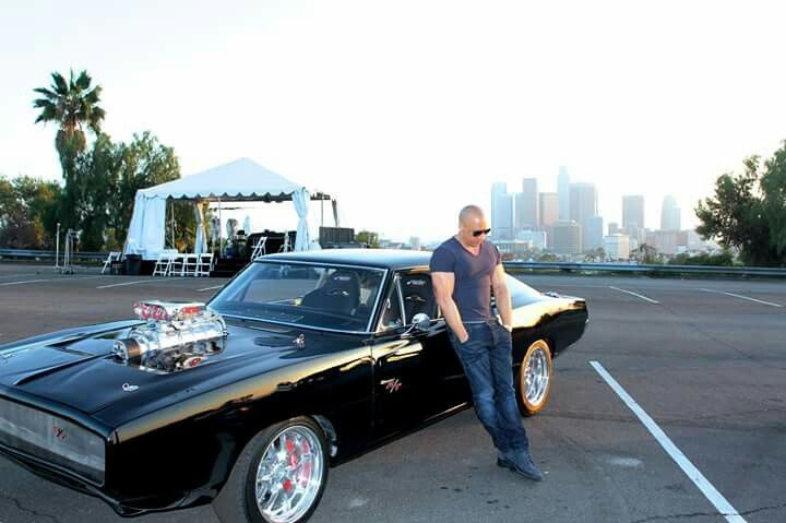 Vin Diesel Standing Next To 1970 Dodge Charger From Fast