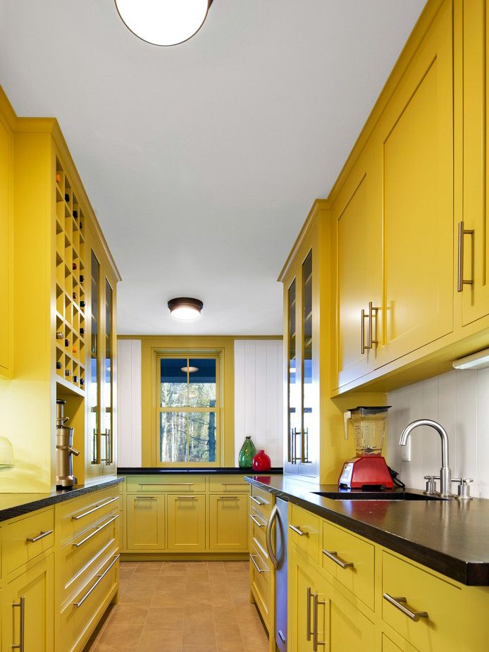 clutter is out and color is in in this galley kitchen design yellow cabinets add a burst of on kitchen remodel yellow walls id=29584