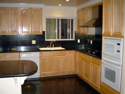 kitchen with black granite and natural oak cabinets ... on Backsplash For Maple Cabinets And Black Granite  id=27048