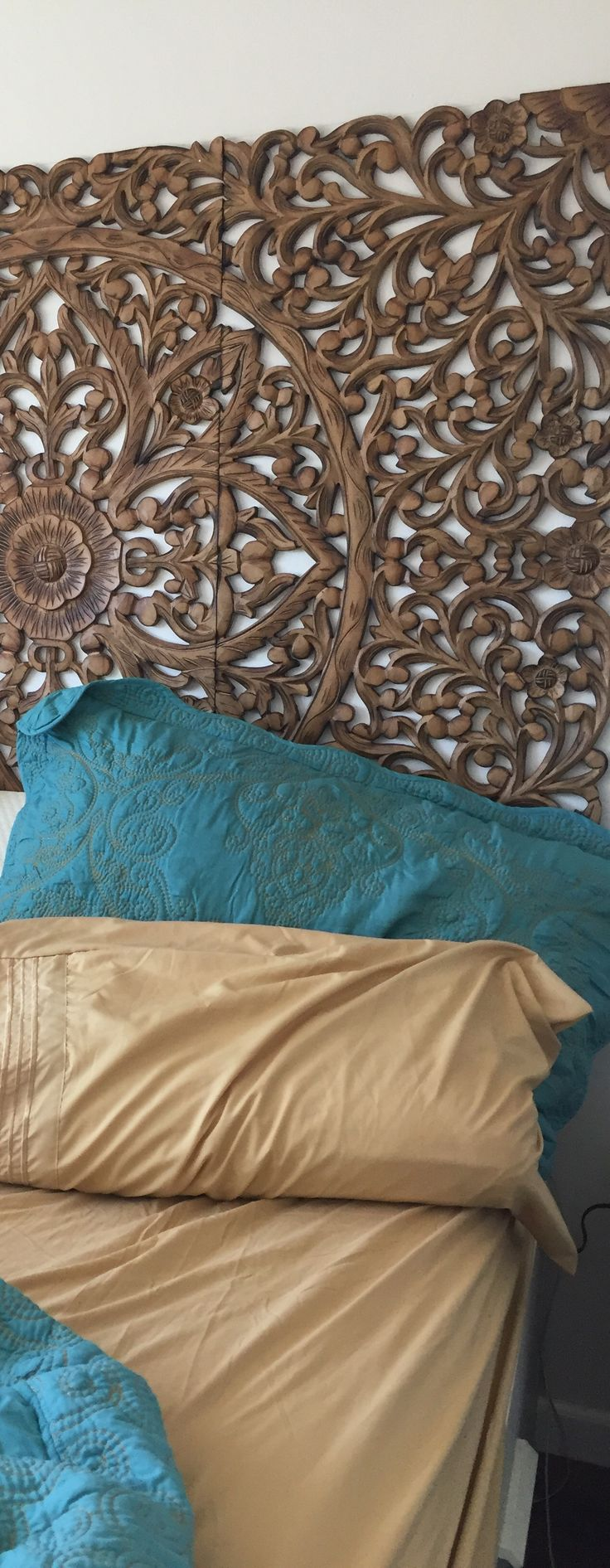 Balinese Carved Wall Art As Headboard And Quilt Teal And