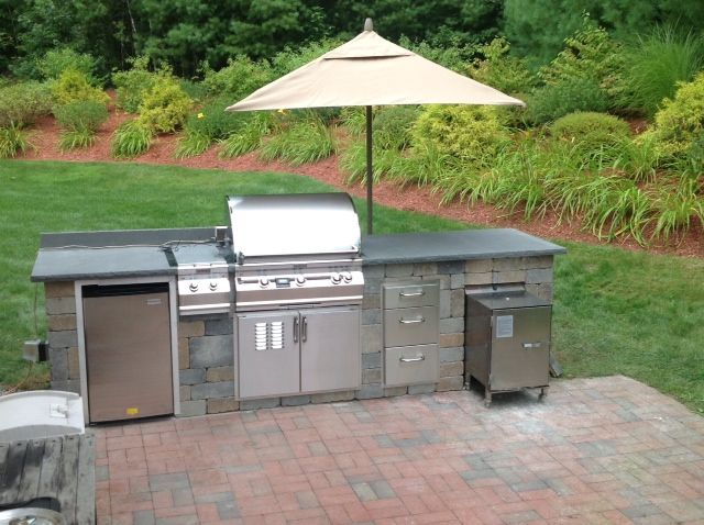 lovely new hampshire outdoor kitchen featuring smokintex smoker model 1400 we love this on outdoor kitchen with smoker id=74263
