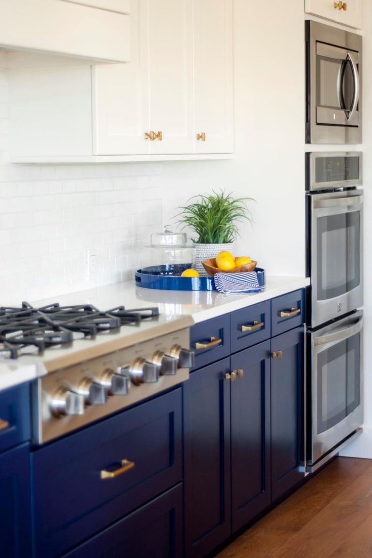 colorful home remodel creates a study in contrasts white counters blue cabinets and gas stove on kitchen cabinets blue id=83460
