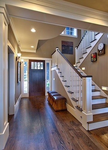 Oak floors with dark walnut stain against simple white trim, love the wall color (painted bead board)–The paint color is Sherwin