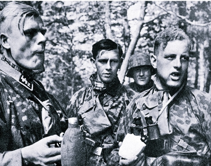 Waffen SS Riflemen Grab A Quick Bite In The Middle Of