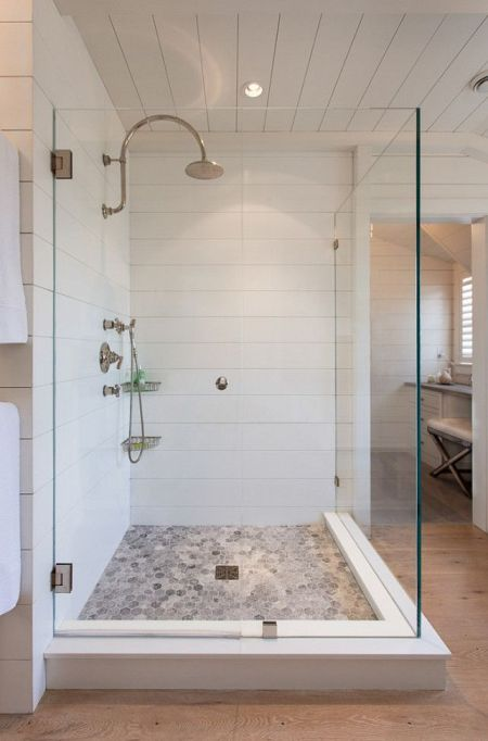 Shower detail:  The builder milled Corian to match the the wooden shiplap coming in from each side.: