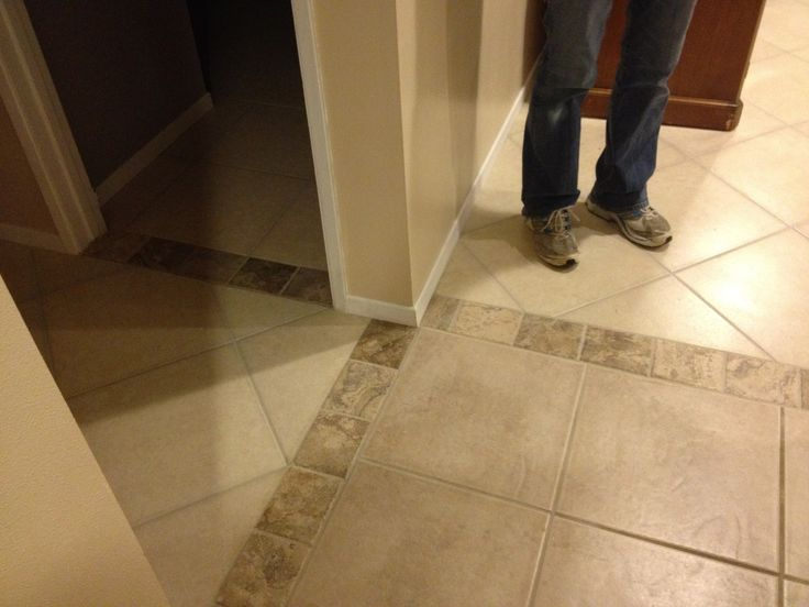Flooring Solution Kim Bought A House With Existing Tile Combined With Cheap Laminate Next To It