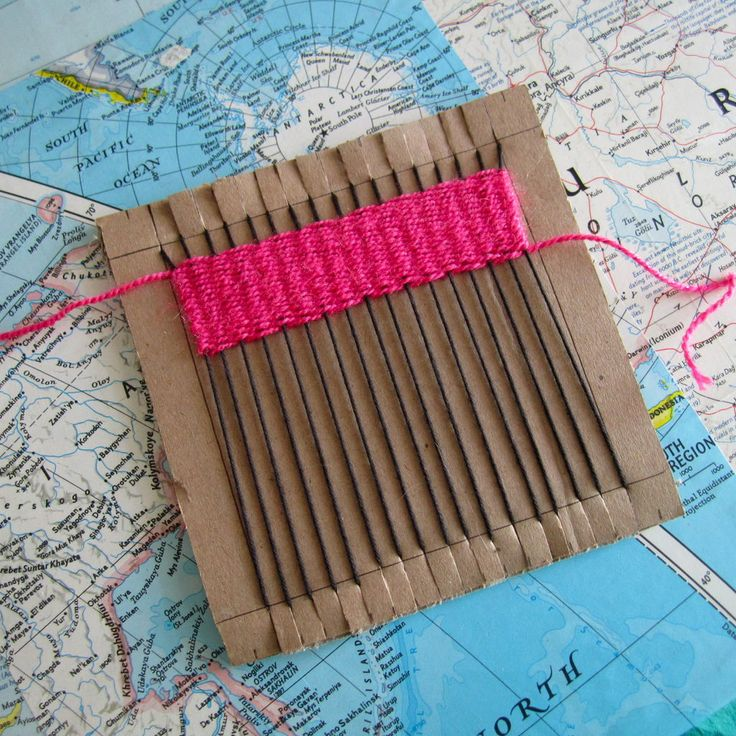 Weaving on cardboard loom – wouldn't it be cool to make a rug like this?