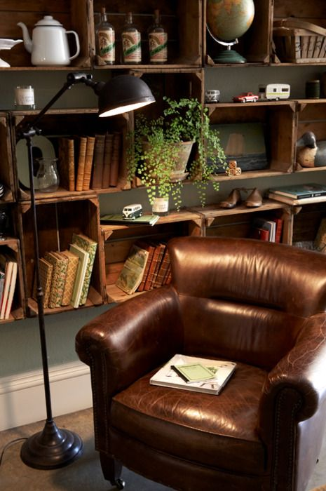 "Love the crate bookcases. Nothing like a ""broken-in"" leather chair:"