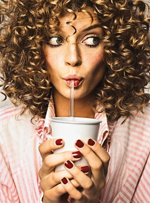 This picture is what I wish I could pull off. Huge curly hair ,red nails and constantly tan skin!