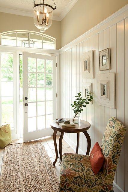 Love the high planks, glass door and lantern light.