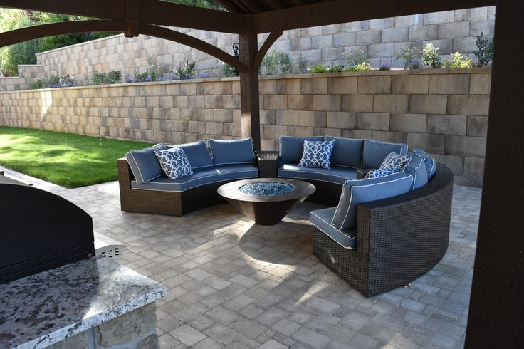 Outdoor living room with metal and glass fire pit beneath ... on Living Room Fire Pit id=82423